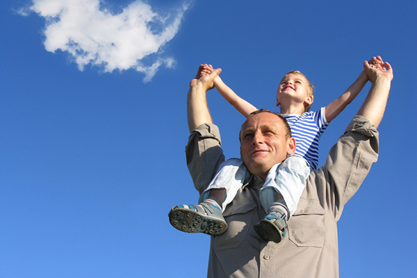 Janice Pliszczak dds dentist in syracuse NY father holding son on shoulders blue sky with cloud iStock 000001475620Small