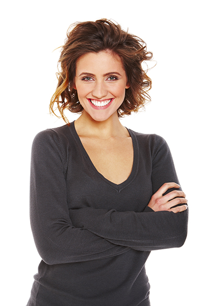 Get a great smile like this woman by going to a cosmetic dentist in Syracuse, NY.